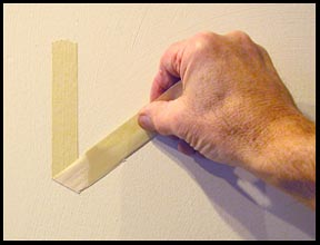 how to hang work with tape